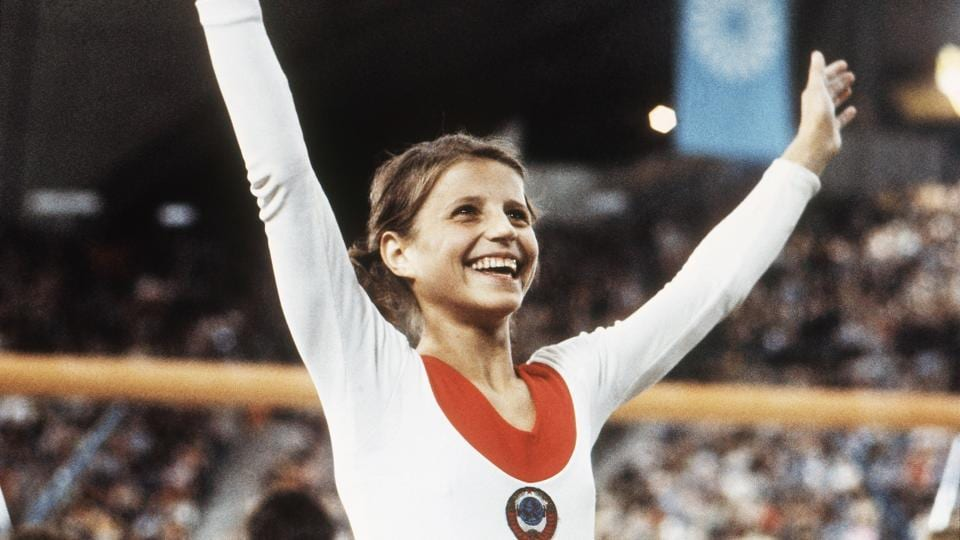In this August 1972 file photo, Olga Korbut of Russia, throws up her arms in joy after winning the individual women's gymnastic event at the 1972 Summer Olympics in Munich. At 61, Korbut enjoys a quiet life in Arizona.