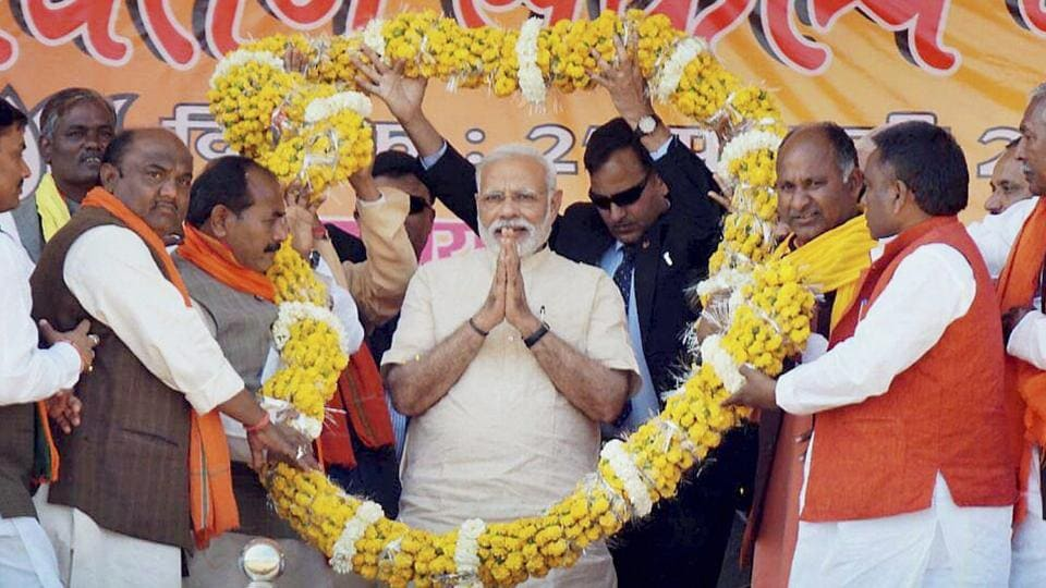 Prime Minister Narendra Modi welcomed at an election rally at Mau in Uttar Pradesh on Monday. PTI