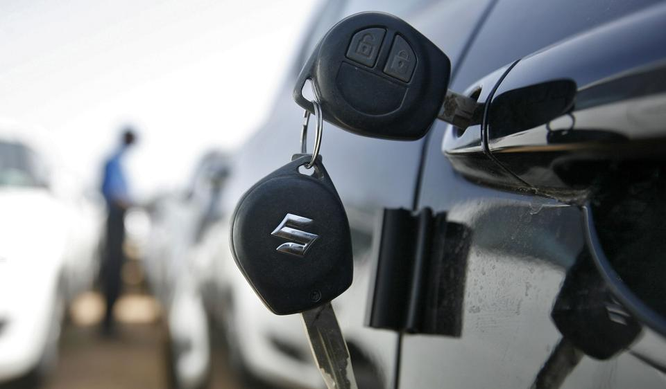 Keys hang from the door of a Maruti Suzuki Swift car. As per the study by BCG-CarDekho, about 42% of all car buyers search online before shortlisting what they want.