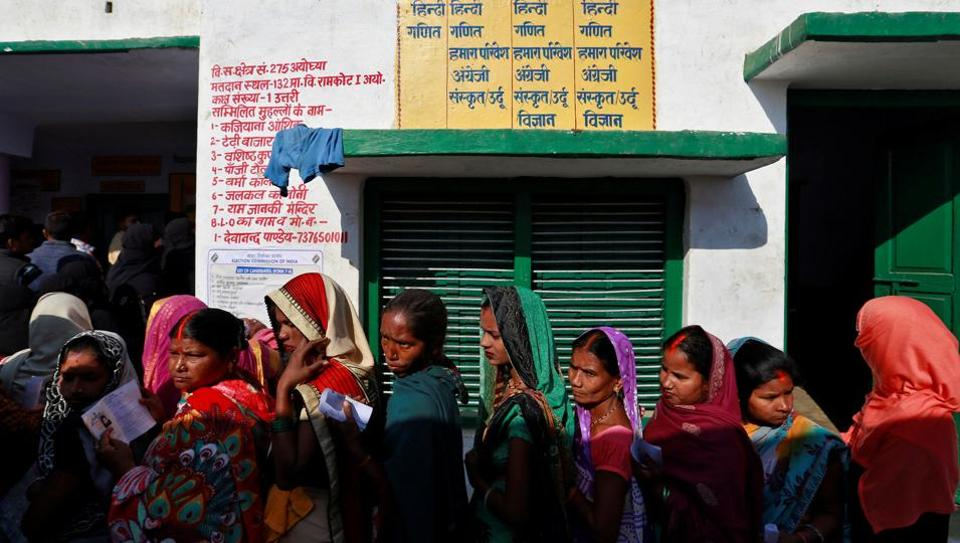 Women queue up to vote during the state assembly election, in the town of Ayodhya, in the state of Uttar Pradesh on  February 27.