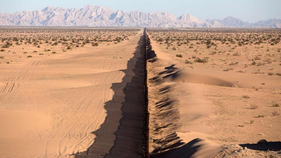 A section of the Mexico-US border fence at San Luis Rio Colorado, Sonora state, northwestern Mexico.  (AFP)