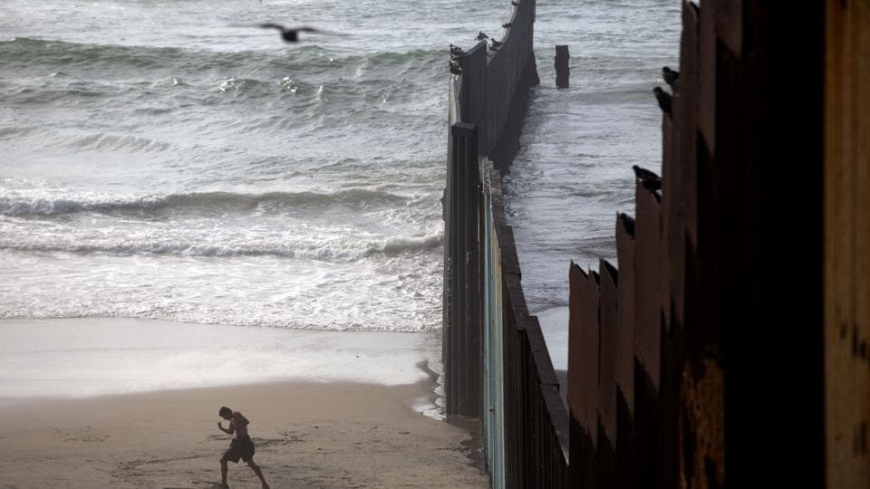 A man working out on the beach next to the Mexico-US border at Playas de Tijuana, northwestern Mexico.  (GUILLERMO ARIAS / AFP)