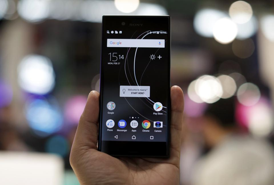 A man holds up a new Sony Xperia device at Mobile World Congress in Barcelona, Spain.