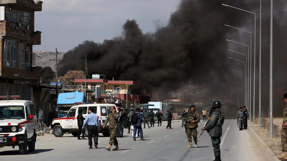 Smoke rises from a district police headquarters after the suicide bombing in Kabul on Wednesday.