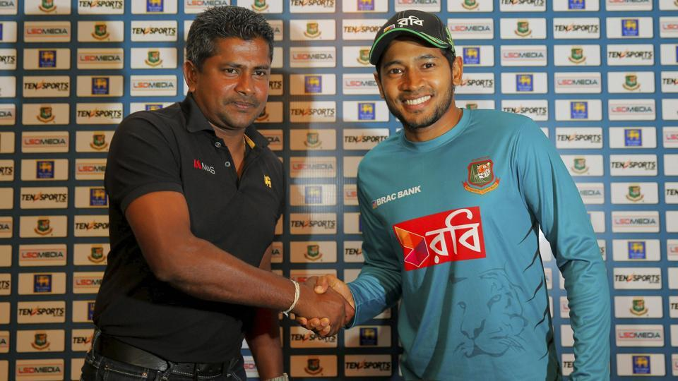 Bangladesh cricket team captain Mushfiqur Rahim, right, shakes hands with his Sri Lanka cricket team skipper Rangana Herath at a media briefing in Colombo.