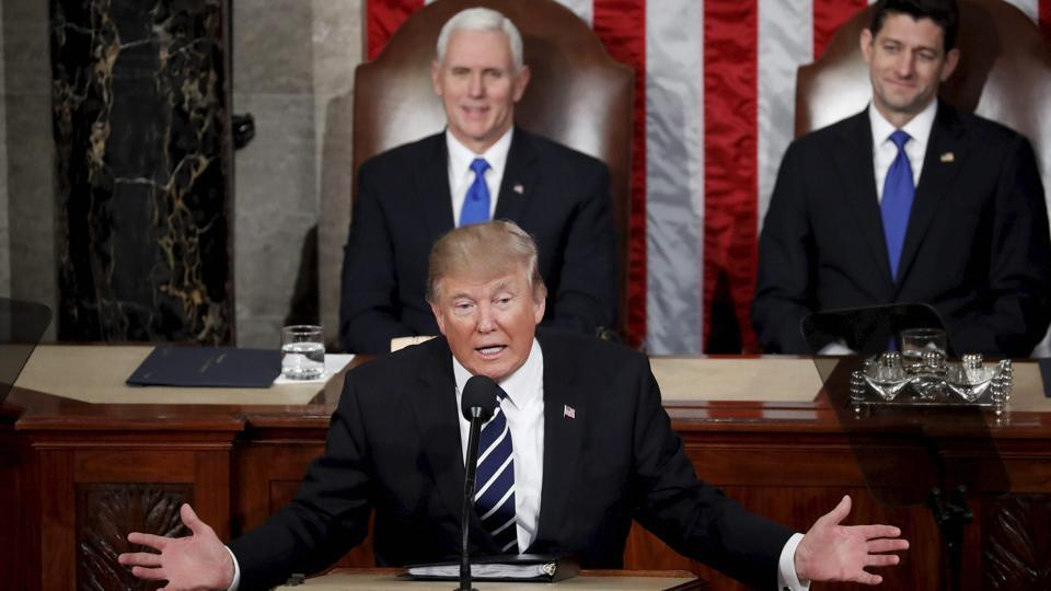 Washington : President Donald Trump addresses a joint session of Congress on Capitol Hill in Washington, Tuesday, Feb. 28, 2017, as Vice President Mike Pence and House Speaker Paul Ryan of Wis. listen.