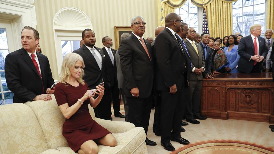 President Donald Trump, right, meets with leaders of Historically Black Colleges and Universities (HBCU) in the Oval Office of the White House in Washington. Also at the meeting are White House Chief of Staff Reince Priebus, left, and Counselor to the President Kellyanne Conway, on the couch.