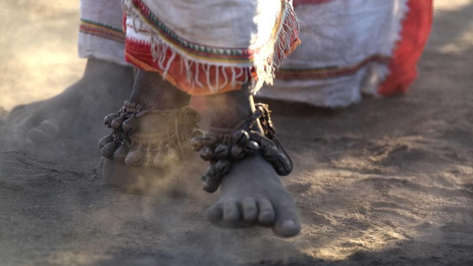 The tribal women dances wearing traditional anklets during the festival. (Arabinda Mohapatra)