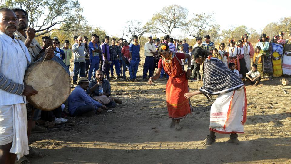 Dongria Kondh tribal beat drums as they sing and chant to their traditional god 'Dharani Penu' and Niyamraja (hill). (Arabinda Mohapatra)