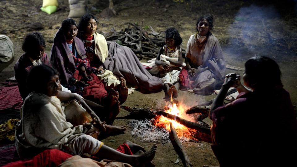The women of the tribe sit around a fire at night taking a break from the day's festivities. (Arabinda Mohapatra)