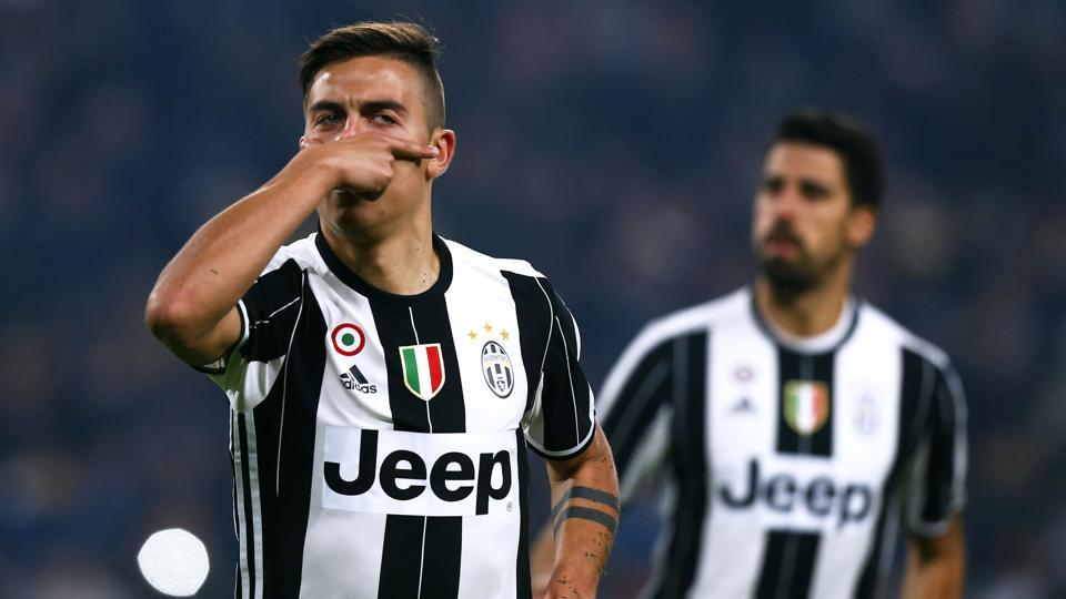 Juventus forward Paulo Dybala (L) celebrates after scoring against Napoli during the Italian Cup match.