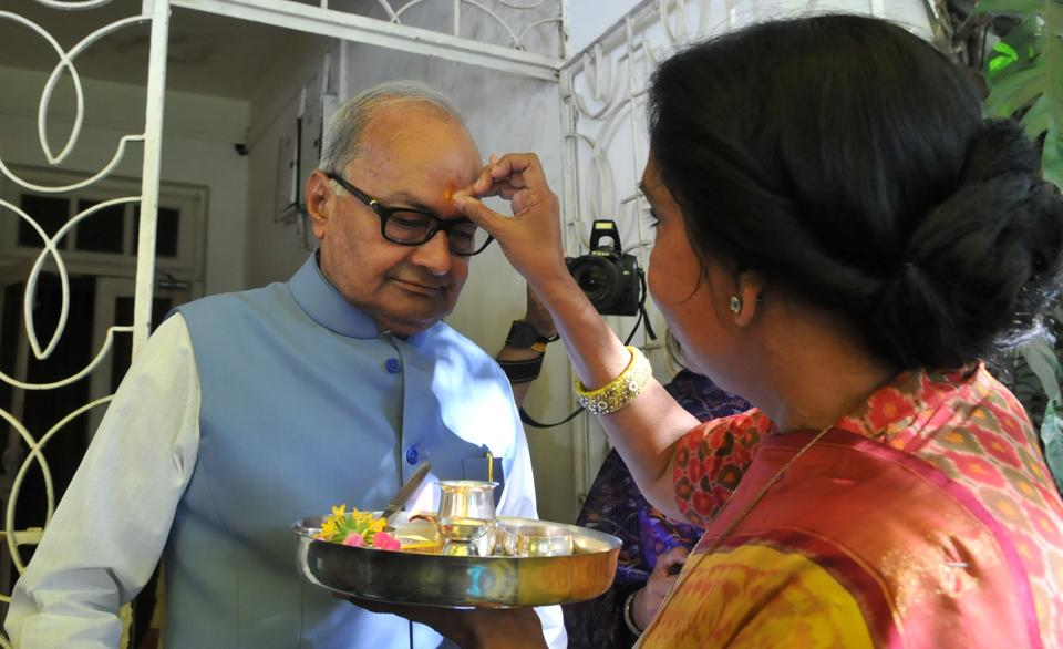 Bhopal, India - March 1, 2017: Wife Sudha Malaiya applying tilak on the forehead of finance minister Jayant Malaiya before he left his bungalow to present the state budget in MP state assembly at Bhopal on Wednesday, March 1, 2017.