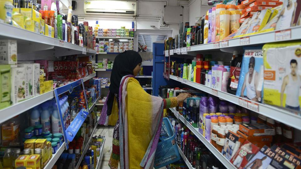 A customer selects products on the shelves in a supermarket in Ahmedabad.