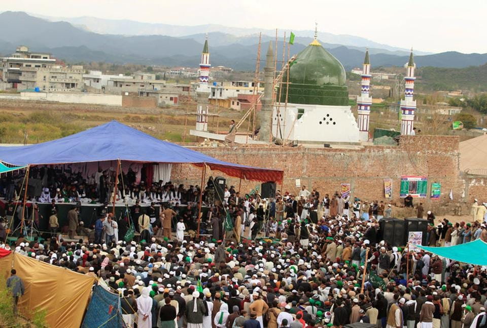 People attend a gathering to mark the anniversary of Mumtaz Qadri's death next to the shrine built over his grave outside Islamabad.