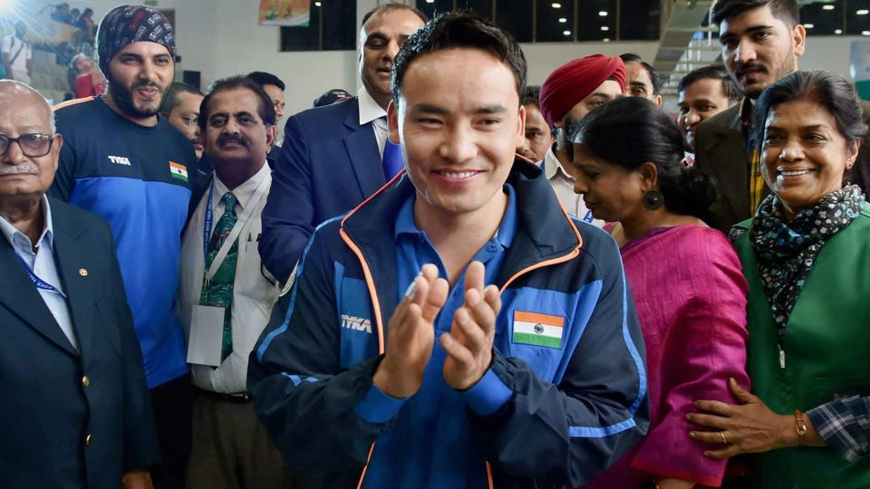 Jitu Rai celebrates after winning gold in the men's 50m pistol event at the ISSF World Cup in New Delhi on Wednesday.