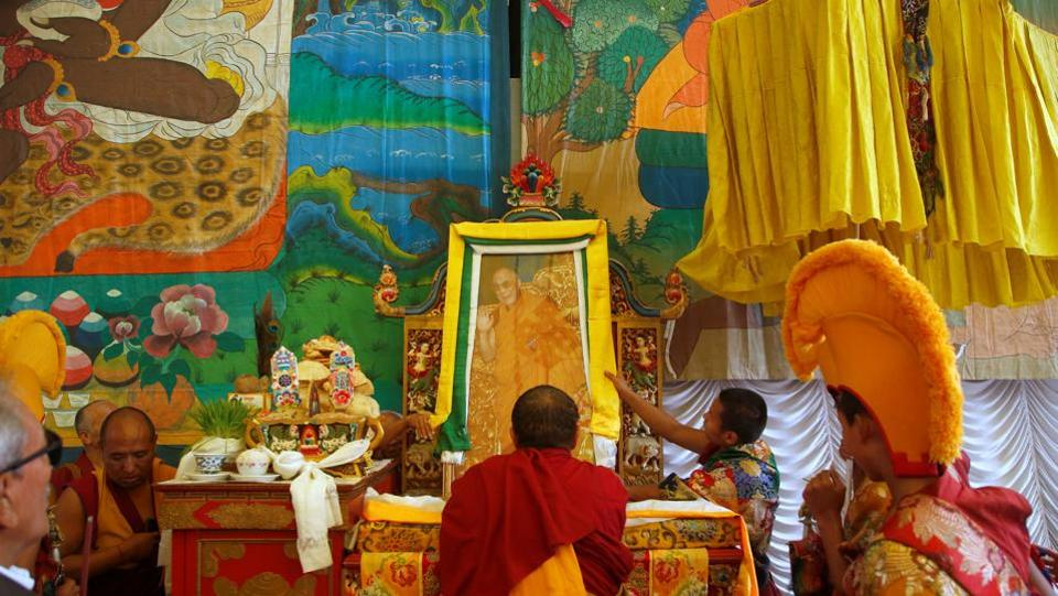 Tibetan monks arrange the portrait of exiled Tibetan spiritual leader, the Dalai Lama, during a function organised to mark 'Losar', or the Tibetan New Year, in Kathmandu. Losar festival, which has its origin in the 15th century, celebrates the Ladakhi or Tibetan New Year. It is said to last 15 days, but the first 3 days are the most important ones. (REUTERS)