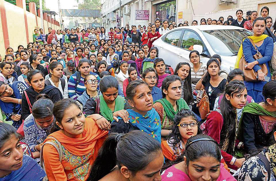Students of Guru Nanak Girls College protesting outside the college gate in Ludhiana on Wednesday.