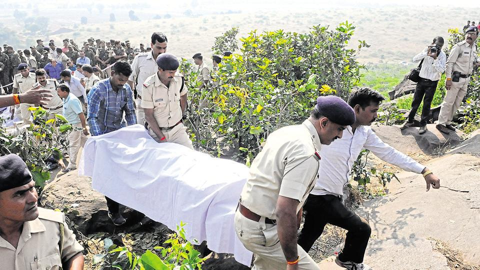 Police personnel carry body of an alleged SIMI operative killed in an encounter on Bhopal outskirts on October 31.