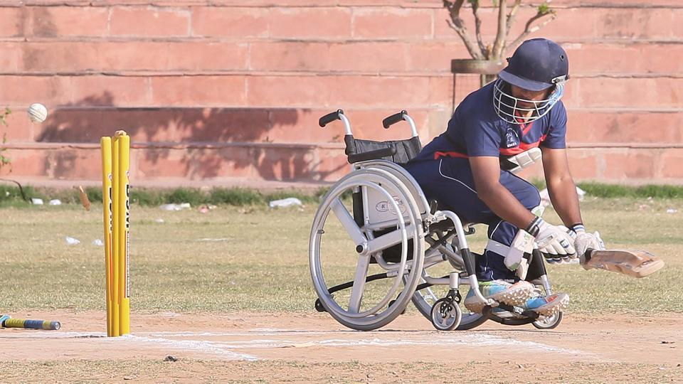 Wheelchair Cricket for the differently abled started in India in 2009 and six states - UP, Haryana, Punjab, Gujarat, Delhi and now Rajasthan have official teams. The best of these players will form the national team aiming for T-20 Wheelchair Cricket World Cup to be held in May 2017 in Nepal. Seen above is Rajasthan's Captain Prithvi Singh bowled out against Punjab during the recently concluded National Triangular Wheelchair T-20 Cricket Series at Chaugan stadium in Jaipur. (Himanshu Vyas / HT Photo)