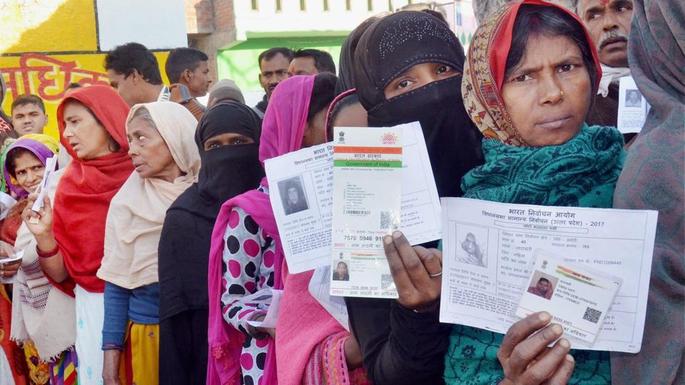 Women queue up at a polling booth in Amethi during the fifth phase of Assembly elections in Uttar Pradesh on Monday.