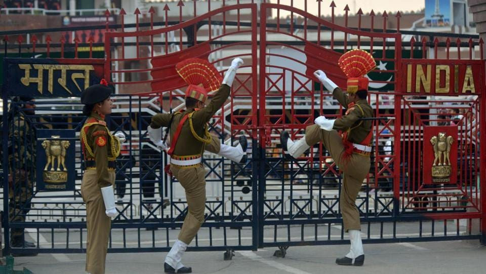 Indian Border Security Force (BSF) personnel symbolically slamming gates shut as they perform during the daily beating of the retreat ceremony on the India-Pakistan Border at Wagah.  (NARINDER NANU / AFP)