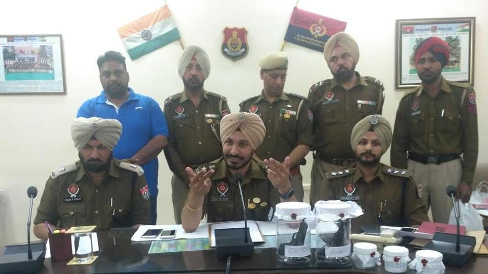 Police interacting with media during a press conference in Sangrur on Thursday.