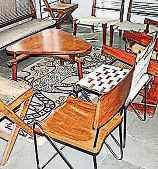 Four furniture items and raw concrete lamp post designed by Swiss architect Pierre Jeanneret including teak stools from Panjab University, coffee table from administrative buildings, executive desk from Punjab and Haryana high court were auctioned.