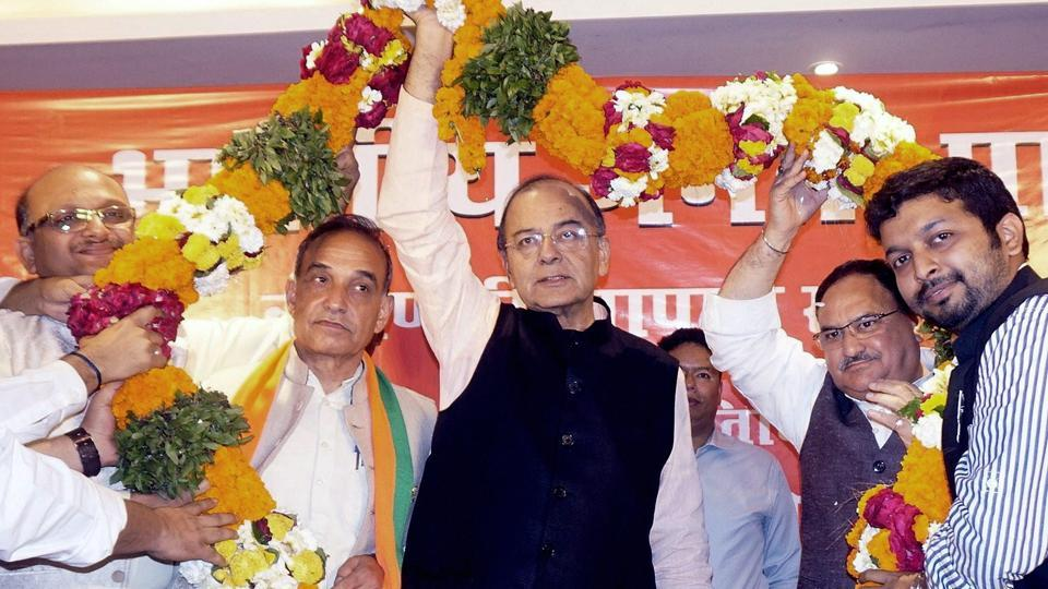 Union finance minister and BJP leader Arun Jaitley being garlanded at the party traders' meet in Varanasi.