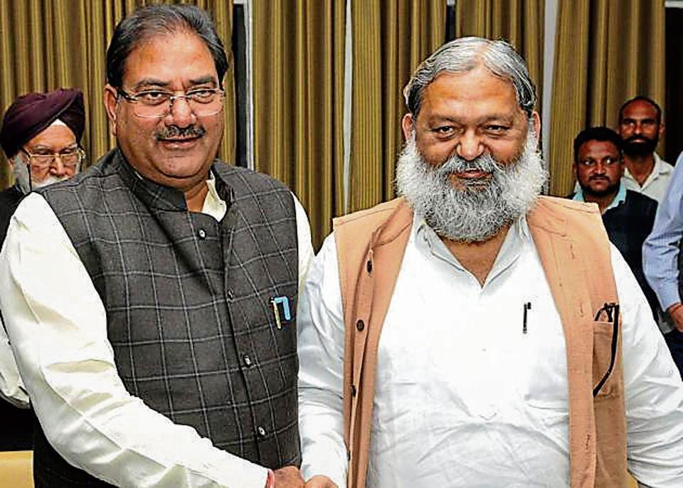 INLD leader Abhay Chautala (Left) and health minister Anil Vij at the Haryana Assembly in Chandigarh on Thursday.