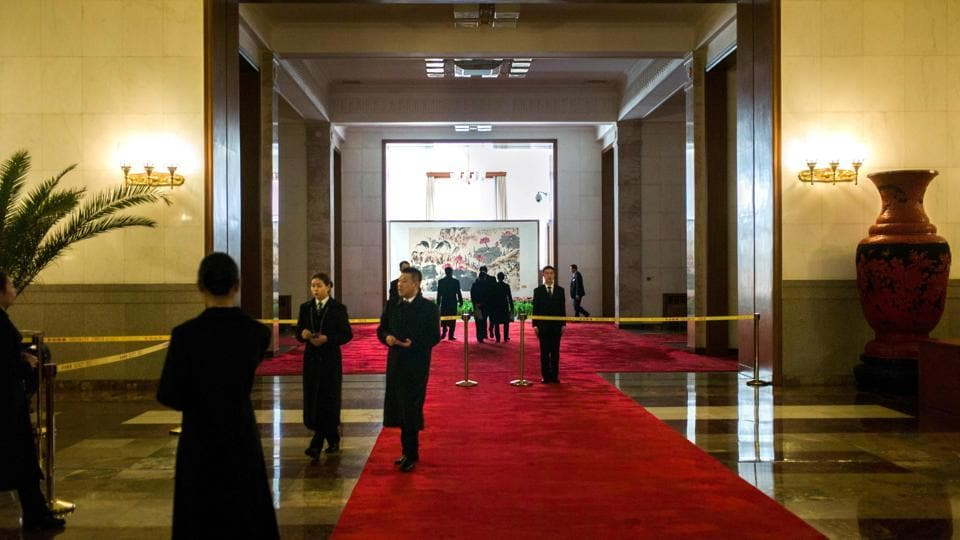 Security guards welcome journalists in the Great Hall of the People ahead of the opening session of the Chinese People's Political Consultative Conference (CPPCC) in Beijing on March 2, 2017. The CPPCC plays a largely symbolic role, with members meeting once a year to discuss social and economic policies.