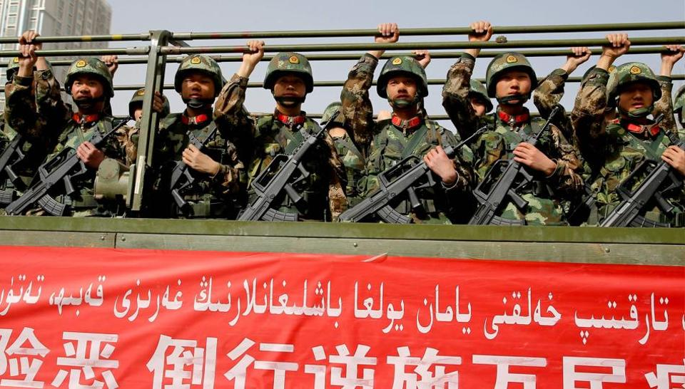 This photo taken on February 27 shows Chinese military police attending an anti-terrorist oath-taking rally in Hetian, northwest China's Xinjiang Uighur Autonomous Region.