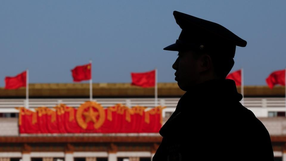 A security guard keeps watch outside the Great Hall of the People ahead of the opening session of the Chinese People's Political Consultative Conference in Beijing on March 2, 2017.