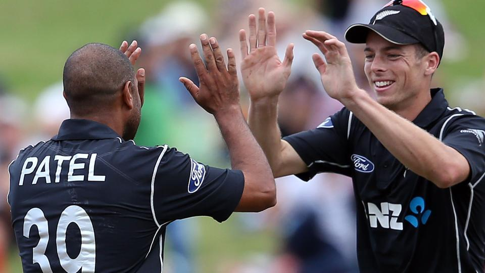 Jeetan Patel (left) and Mitchell Santner of New Zealand celebrate the run out of Dwaine Pretorius of South Africa during the fourth ODA vs South Africa at Seddon Park in Hamilton on Wednesday.