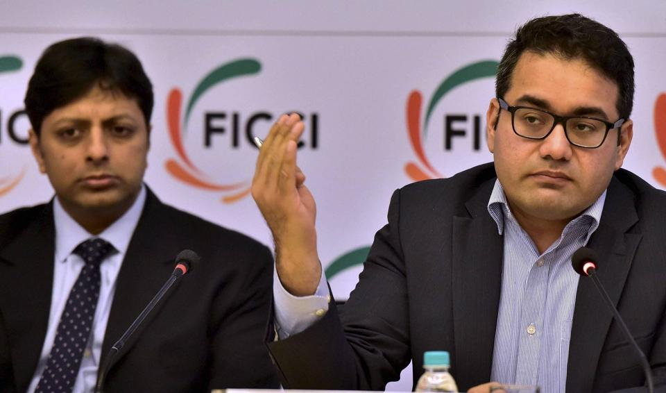 New Delhi: Snapdeal CEO Kunal Bahl (R) and Amazon's Country Head Amit Agarwal (L) address a press meet organised by FICCI on e-commerce industry in India, in New Delhi.