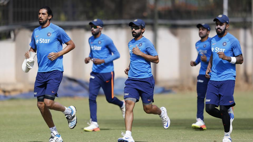 Indian cricketers warm up during a training session ahead of their second cricket test match against Australia in Bangalore, India, Wednesday, March 1, 2017. (AP Photo/Aijaz Rahi) (AP)