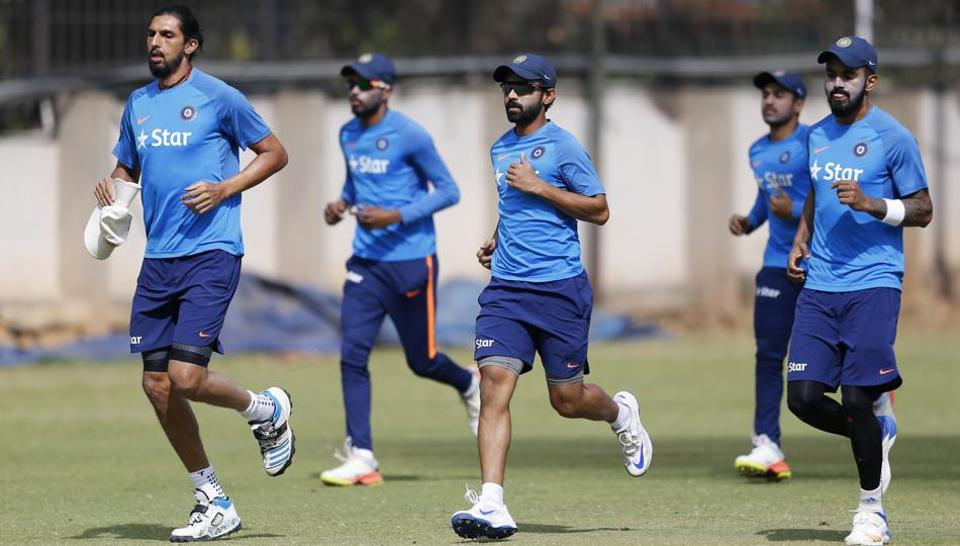 Indian cricketers warm up during a training session on Wednesday ahead of the second Test against Australia in Bangalore.