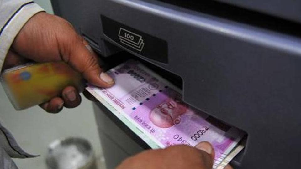 Indore, India - Nov. 18, 2016: A man takes out Rs 2000 currency note from an ATM in Indore, India, on Friday, November 18, 2016. (Photo by Shankar Mourya/ HT/ PHOTO) With Manoj Ahuja story
