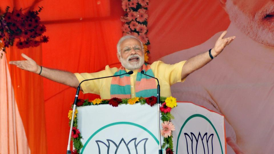Prime Minister Narendra Modi addresses an election campaign rally in Maharajganj district on Wednesday.