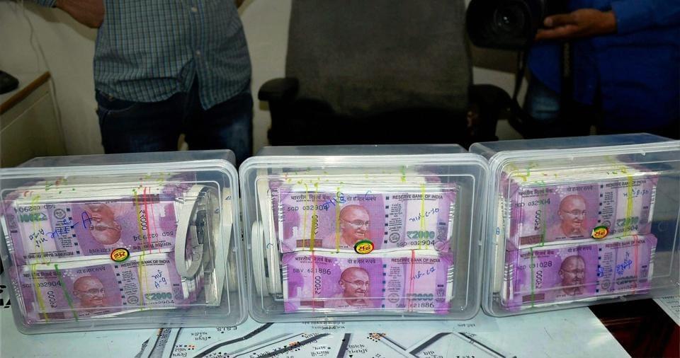 Rajkot : Police seize fake Rs 2,000 notes at Rajkot City on Saturday. PTI Photo(PTI2_25_2017_000156B)