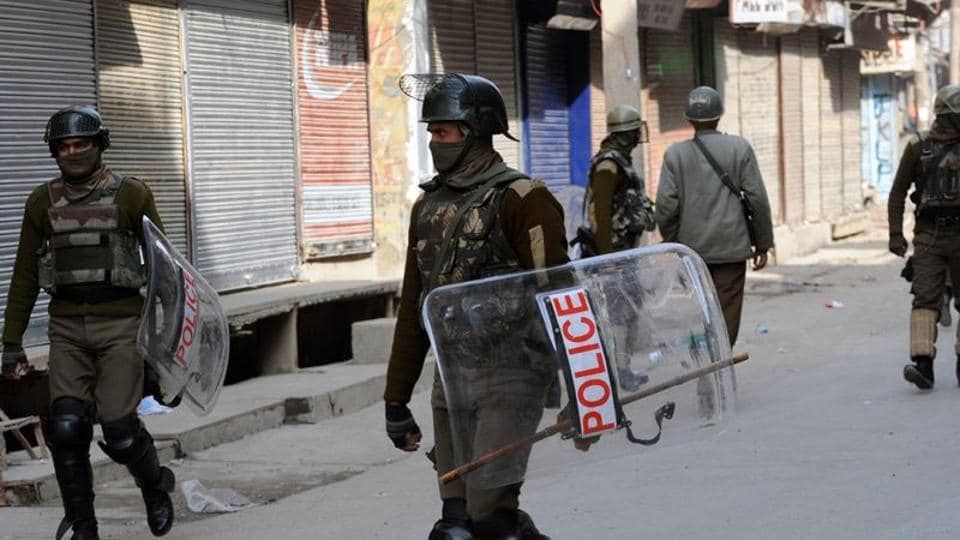Central Reserve Police Force (CRPF) soldiers stand guard during a curfew in Srinagar.