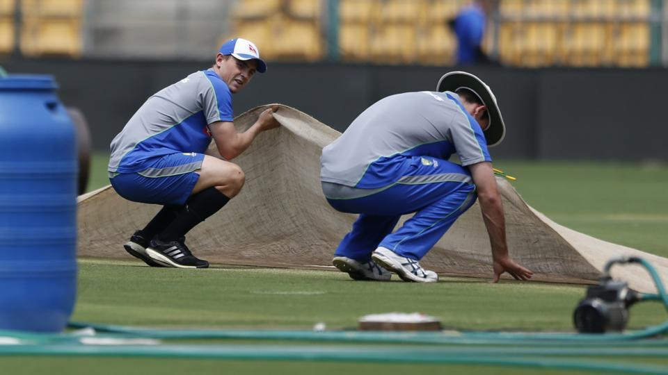 Australia's Steve O'Keefe, left, and Mitchell Marsh check out the Chinnaswamy Stadium pitch in Bangalore on Wednesday. The second India vs Australia Test starts in Bangalore on Saturday.