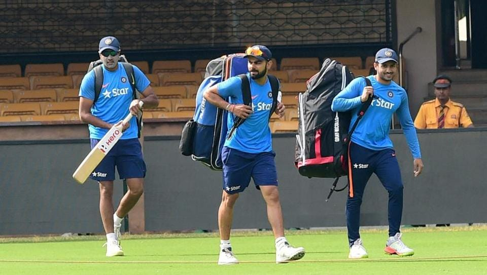 Indian cricket team captain Virat Kohli, R Ashwin and Karun Nair arrive for a training session ahead second Test against Australia in Bangalore.