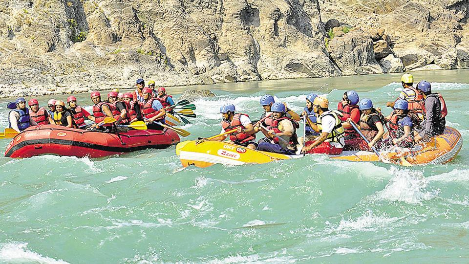 Tourists enjoying water rafting at river Ganga in Rishikesh