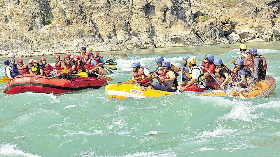 Tourists enjoying water rafting at river Ganga in Rishikesh