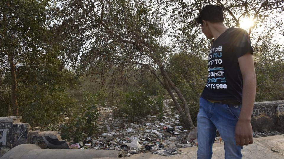 The body was found in a plastic bag in a vacant plot of land used to dump garbage.