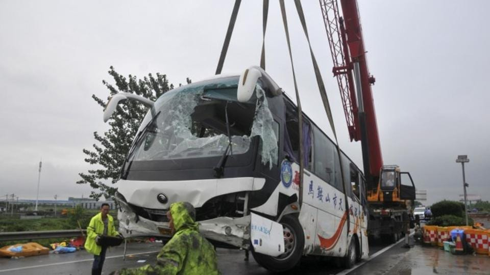 The bus carrying 47 people collided with a cement truck late Thursday night near a tunnel in Lincang city in Yunnan province