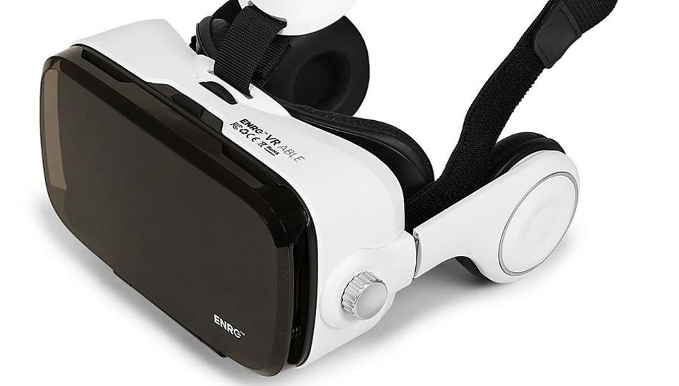 The headset comes with attached headphones and, as whole, the device works as a portable theatre