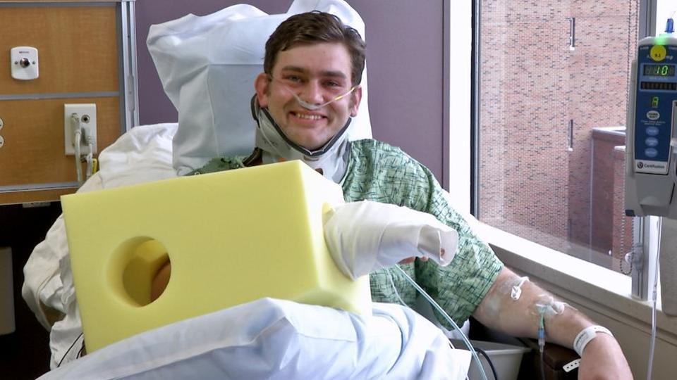 This Feb. 23, 2017 image from a video provided by The University of Kansas Health System shows Ian Grillot, of Grandview, Mo., during an interview in the University of Kansas Hospital in Kansas City.