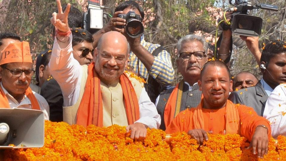 BJP president Amit Shah with party MP Yogi Aditya Nath during an election road show in Gorakhpur district on Thursday.