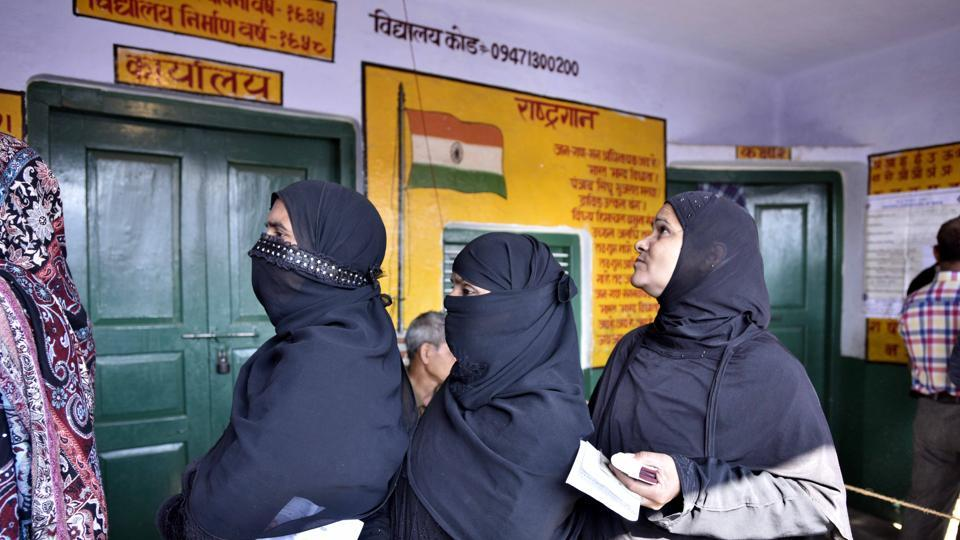 Voters queue up to cast votes at a polling station in Ayodhya,  February 27.